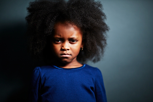 Sad looking girl with afro